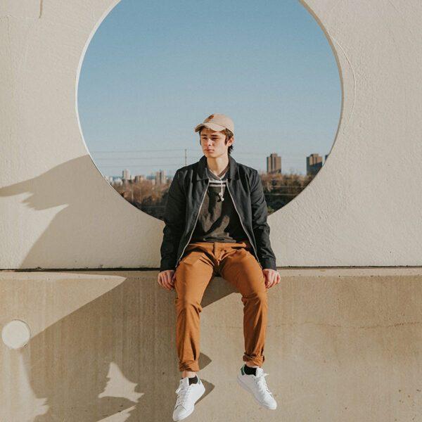 Teenage boy sitting on a wall